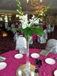 eiffel tower vase with hydrangea and seeded eucalyptus reception