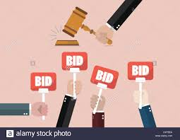 bid auction auction and bidding concept holding auction paddle stock