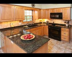 light wood kitchen cabinets with black countertops pin by k g on kitchen design kitchen design small
