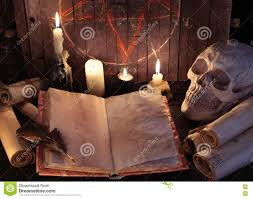 free halloween background paper open witch book with paper scrolls and evil candles against