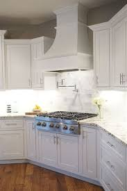 white shaker corner kitchen cabinet kitchen ideas diy and create range vent