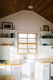 293 best tiny house dreams images on pinterest tiny house swoon the monocle by wind river tiny homes open shelving custom steel brackets farmhouse sink butcher block countertops shiplap siding