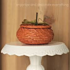 wicker basket pumpkin and fall harvest hop organize and decorate