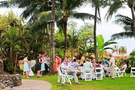 old lahaina luau wedding with white orchid wedding hawaiian