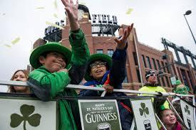 st patrick u0027s day revelers clad in green pack denver streets for