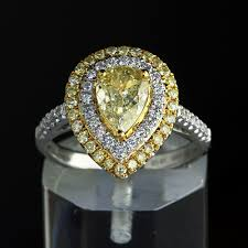 fancy yellow diamond engagement rings 2 55 ct fancy yellow pear shape diamond engagement ring big