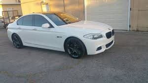 bmw white car white car with black wheels does this look right