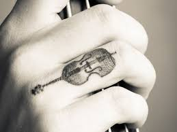 7 stunning guitar wrist tattoos
