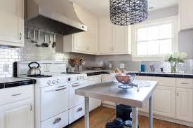 white cabinets with black countertops and backsplash 15 stunning kitchen backsplashes diy network made