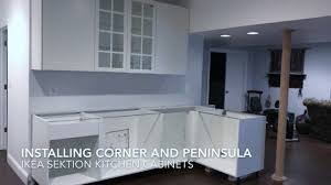 how to assemble ikea kitchen cabinets installing ikea sektion cabinets corner peninsula youtube