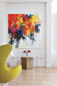 in the living room white walls showcase a vibrant oil painting