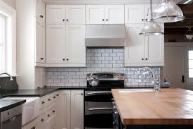 Soapstone Subway Tile Butcher Block And Black Granite Countertops With White Cabinets