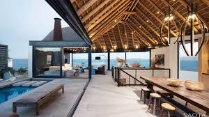 ocean view contemporary luxury home with thatched roof modern