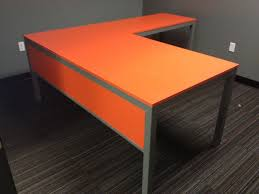 l shaped desk all welded steel with gray powder coating and orange