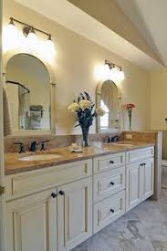 Medallion Bathroom Cabinets by Dura Supreme Cabinetry With Barcelona Classic Antique White With