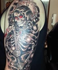 black and red grim reaper with clock tattoo on man left half sleeve