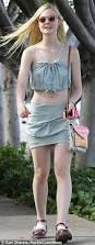 elle fanning shows athletic side before changing into trendy