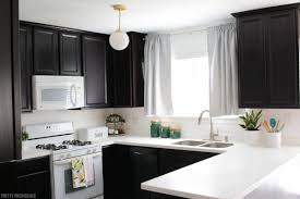 espresso kitchen cabinets with white countertops before and after kitchen makeover pretty providence