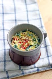 5 minute spinach and cheddar microwave quiche in a mug bowl of