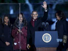 obama family and reese witherspoon headline national christmas