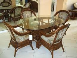 oval shape dining table minimalist oval glass top dining table with rattan chairs within