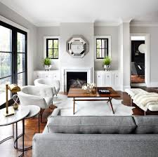 White Walls Grey Trim by Black Trim Tan Walls Living Room Transitional With White Armchairs
