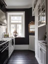 clique studios kitchen cabinets gravity home black and white kitchen in a vintage studio apartment