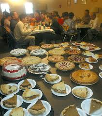 donated baked goods cover a table at a thanksgiving dinner put on