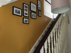 mustard feature wall hall stairs and landing dulux endurance
