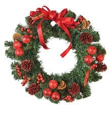 pine needles wreath with berries pine cones and bow for christmas