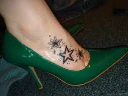 40 classy star tattoo on foot