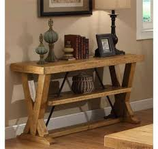 rustic wooden console table with a bottom shelf and decorated with