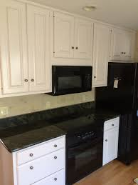 white kitchen cabinets refinishing after oak cabinets and