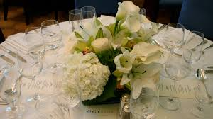 White Centerpieces Pink Flowers On The White Vases Feat White Plate Placed On The