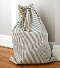 travel laundry bag images Over on ehow sew a simple drawstring laundry bag 17 apart jpg