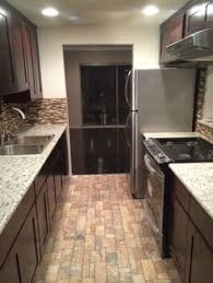 Kitchen Small Galley Kitchen Makeover With Brick by Traditional Kitchen With 2 In Quartz Countertop In Alpina White