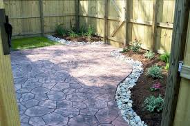 Cracked Concrete Patio Solutions by Townhouse Backyard With Stamped Concrete Patio And Simple