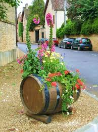 impressive diy wine barrel planters that you can make in no time