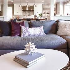 dark brown velvet sectional with purple pillows and sectional