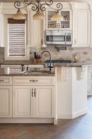 Looking For Kitchen Cabinets This Vanilla Créme Paint With A Van Dyke Brown Glaze Cabinet Is
