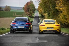 porsche with christmas tree turbo two step porsche 911 carrera s vs mercedes amg c63 s coupe