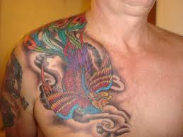 colored phoenix tattoo on chest for men tattooshunt com