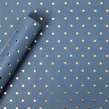 sugar paper gold foil signature dot on navy wrapping paper