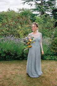 a pale green dress and first look for a feminist wedding in