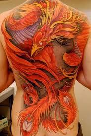 colorful phoenix tattoo on whole back by johan finne phoenix
