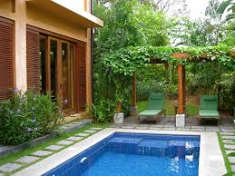 private plunge pool surrounded by lush gardens at our rental villa