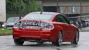 red bmw m4 bmw m4 facelift and hotter prototype spied up close