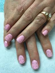 cotton candy soft pink gel nails with speckled glitter to bling