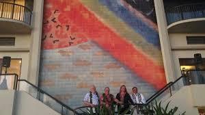 hilton hawaiian village in waikiki unveils renovated rainbow mural hilton hawaiian village in waikiki unveils renovated rainbow mural slideshow pacific business news
