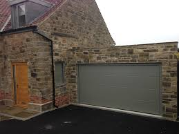 hormann l ribbed sectional in stone grey by abi garage doors